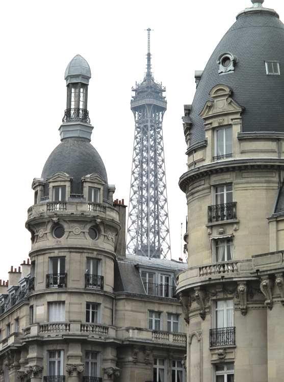 Eiffel Tower between buildings